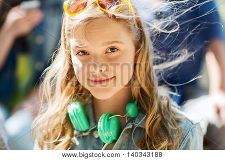 people, summer and portrait concept - happy teenage girl with headphones