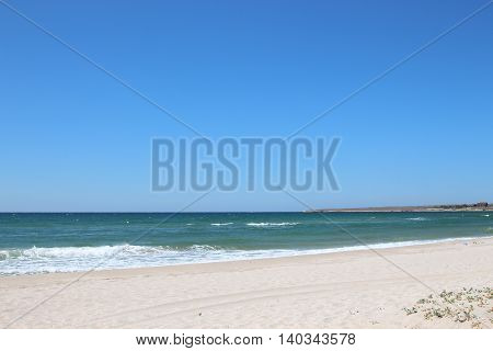 Sea view from the sandy beach during the day