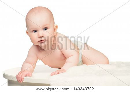 Sweet baby in a towel after bath. Healthcare, pediatrics. Isolated over white.