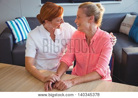 Nurse taking care of a senior woman in a retirement home