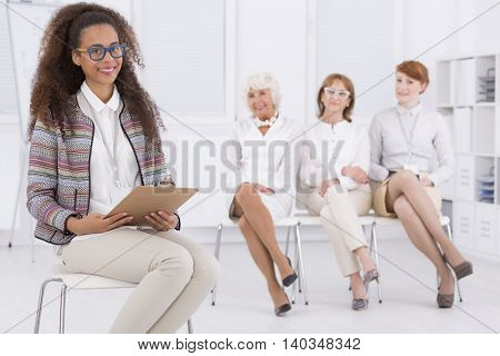 Shot of a young african woman holding a job interview