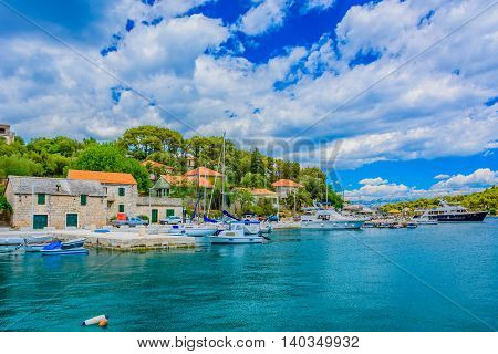 Small touristic mediterranean town Rogac on Island of Solta, waterfront summertime view, Croatia Europe.