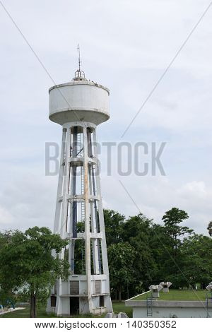 Water Tank Tower with white cloud, abandon water tank tower