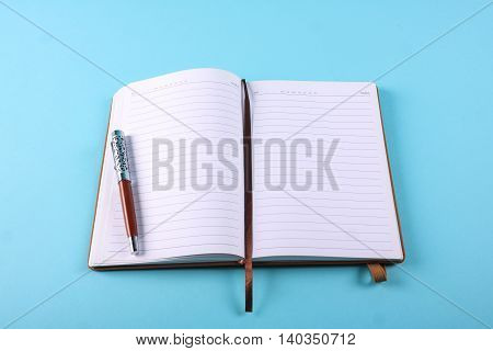 Planner Notebook In Blue Pastel Background