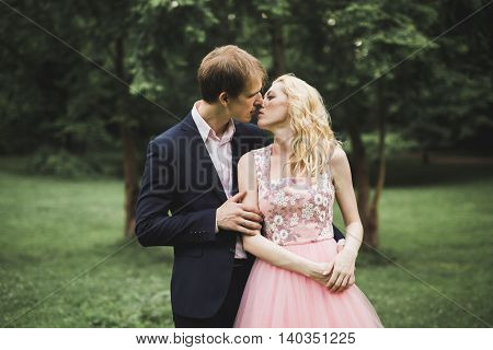 young couple in love having fun and enjoying the beautiful nature.