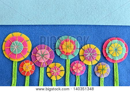 Beautiful bright flowers made of felt circles. Needlework idea. Crafts flowers embellishments. Background for greeting card for birthday, Valentine's day, Easter, holiday