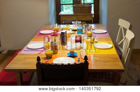 Breakfast at the table with eggs and orange juice