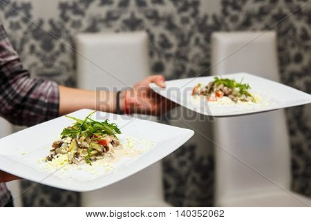 the waiter brought the salads on the Banquet table
