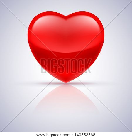 Shiny red heart with reflection on grey background