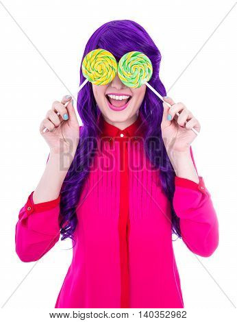 Happy Woman With Purple Hair Covering Her Eyes With Two Lollipops Isolated On White