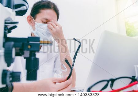 Tired Overworked Scientist Woman At Lap Covering Her Face With Hands,science Content,science Concept