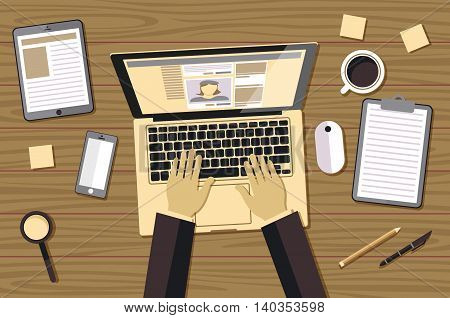 Man Sitting With Laptop On The Wooden Floor And Working, Hands Typing A Message In Social Networks.