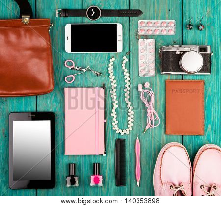 Shoes, Tablet Pc, Smart Phone, Camera, Headphones, Bag, Notepad, Watch, Passport And Essentials On B