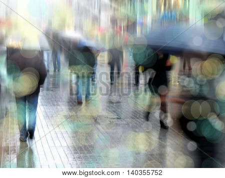 people walking on busy city street in rainy day