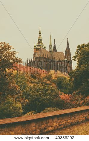 Prague Castle, old city with autumn trees , european travel seasonal fall background in vintage style