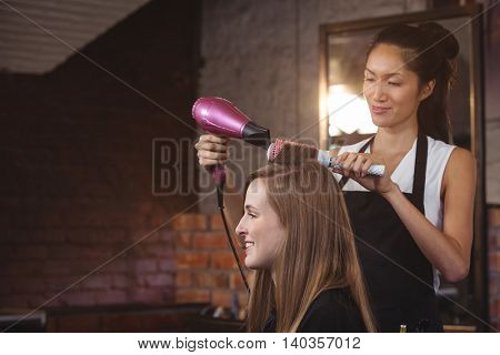 Hairdresser styling customers hair at a salon