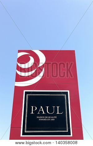 Masseret, France - June 23, 2016: Paul logo on a wall. Paul is a French chain of bakery café restaurants established in 1889 in France. It specializes in serving French products including breads, sandwiches, macarons, cakes, pastries