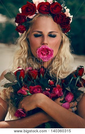 Retro vintage style portrait of beautiful blonde woman with roses
