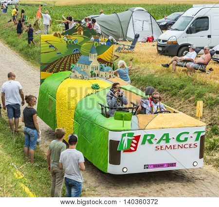 QuievyFrance - July 07 2015: RAGT Semences vehicle during the passing of the Publicity Caravan on a cobblestoned road in the stage 4 of Le Tour de France on July 7 2015 in Quievy France. RAGT Semences is an important french producer of variuos types of se
