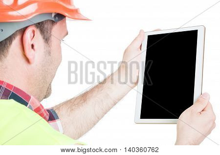 Back View Of Constructor Holding Tablet