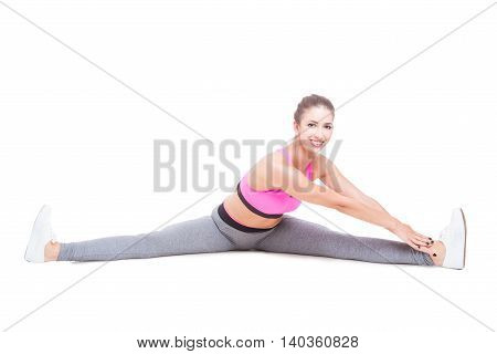 Woman Wearing Sports Wear Stretching Legs Before Workout