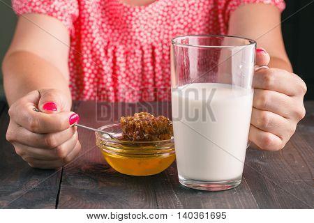 Oung Woman Having Healthy Breakfast In Kitchen