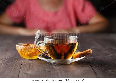 herbal tea with honey on wooden table