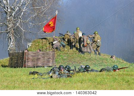 MOSCOW REGION - OCTOBER 13, 2013: Reenactors dressed as WW II soldiers. The battle they are reenacting was the Moscow Battle held in 1941.