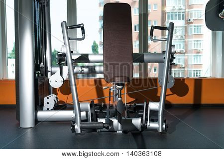 Various equipment, trainers, and exercise machines at the modern gym room