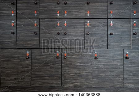 Storage with lockers of various size with many keys hang