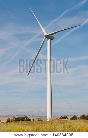 Wind turbine in the countryside. Clean alternative renewable energy. Vertical