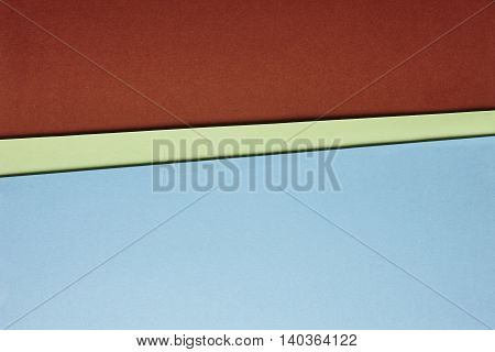 Colored cardboards background in blue green brown tone. Copy space. Horizontal