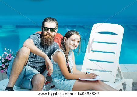 Happy Small Girl And Man At Swimming Pool