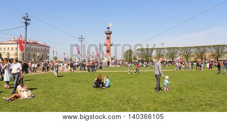 St. Petersburg, Russia - 9 May, People on the lawn of the Spit of Vasilyevsky Island, 9 May, 2016. Vacationers people on the lawns and gardens in the city.