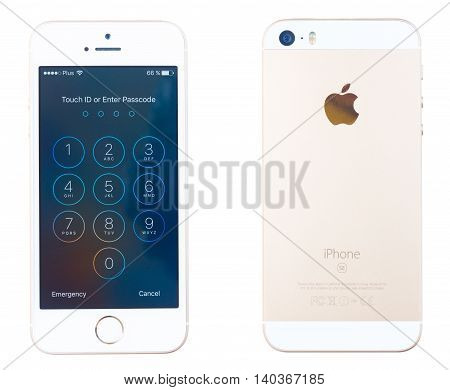 WARSAW, POLAND - JULY 17: New Iphone 5 SE in golden color - back and face side with lock page