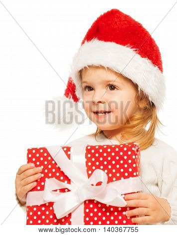Little happy girl holding a cap of the present box with white bow in her hands close portrait isolated