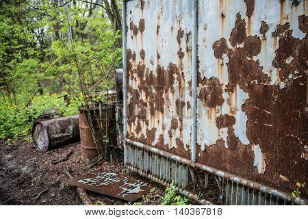CHERNOBYL, UKRAINE-MAY,20: rusty booth and barrels with green plants in abandoned on May 20, 2016 in Pripyat