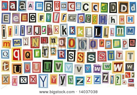 Colorful alphabet made of magazine clippings and letters . Isolated on white.