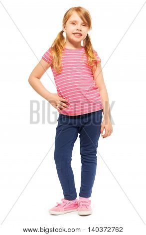 Full-length picture of beautiful seven years old girl in tee and leggings, posing at the camera, isolated on white