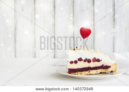 Birthday or Valentines day cake with red bilberry and white chocolate. Selective focus