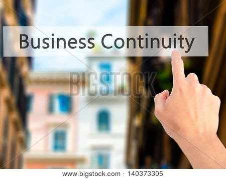 Business Continuity - Hand Pressing A Button On Blurred Background Concept On Visual Screen.