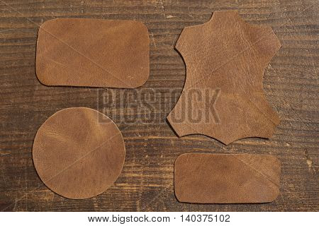Grunge leather labels on a wooden background