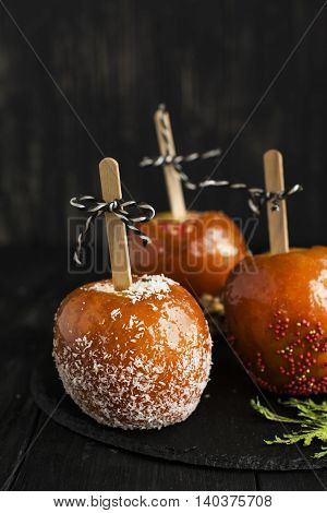 Homemade sweet halloween candy apples. Fall or harvest card in dark style. Selective focus