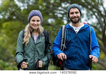 Portrait of happy hiker standing at countryside