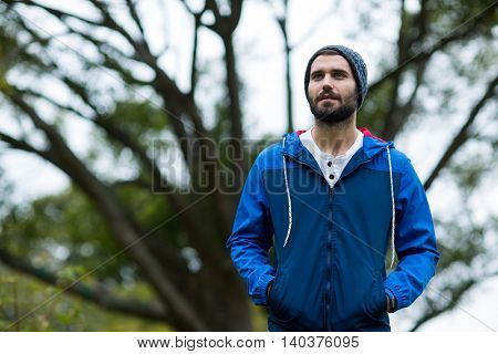 Handsome hiker standing at countryside