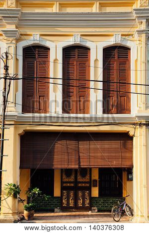 GEORGE TOWN MALAYSIA - MARCH 24: Facade of the old building located in UNESCO Heritage Buffer Zone Armenian Street George Town Penang Malaysia on March 24 2016.