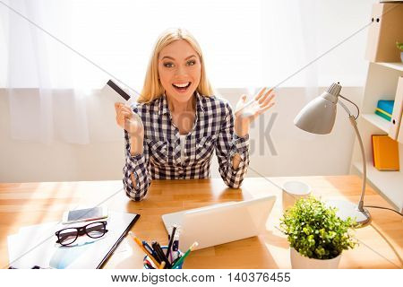 Portrait Of Happy Excited Woman Holding Bank Card