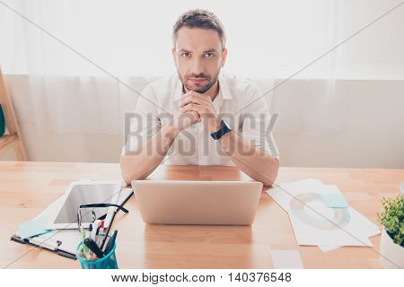 Portrait Of Unhappy Exhausted Man With Laptop Thinking About Hard Task
