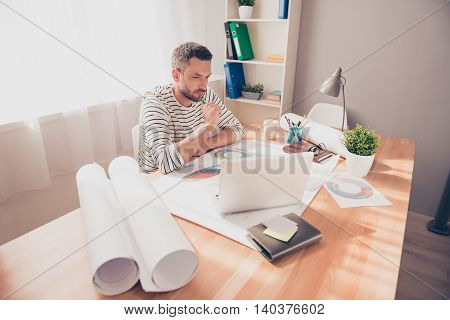 Portrait Of Concentrated Engineer Thinking About Hard Task