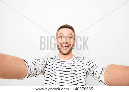Happy Cheerful Handsome Man Making Funny Selfie